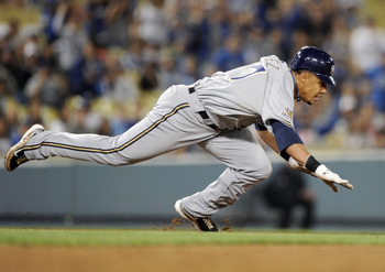 LOS ANGELES, CA - MAY 05:  Carlos Gomez #27 of the Milwaukee Brewers dives back into 2nd base during a run down in the eighth inning against the Los Angeles Dodgers at Dodger Stadium on May 5, 2010 in Los Angeles, California.  (Photo by Harry How/Getty Im