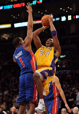 LOS ANGELES, CA - JANUARY 04:  Kobe Bryant #24 of the Los Angeles Lakers shoots a jumper over Tracy McGrady #1 of the Detroit Pistons at the Staples Center on January 4, 2011 in Los Angeles, California. NOTE TO USER: User expressly acknowledges and agrees