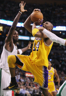 BOSTON, MA - FEBRUARY 10:  Kobe Bryant #24 of the Los Angeles Lakers heads up for the basket as Ray Allen #20 and Kevin Garnett #5 of the Boston Celtics defend on February 10, 2011 at the TD Garden in Boston, Massachusetts.  The Lakers defeated the Celtic