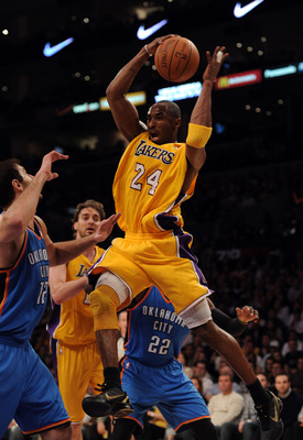LOS ANGELES, CA - JANUARY 17:  Kobe Bryant #24 of the Los Angeles Lakers grabs a rebound in front of Nenad Krstic #12 of the Oklahoma City Thunder at the Staples Center on January 17, 2011 in Los Angeles, California.  (Photo by Harry How/Getty Images)   N