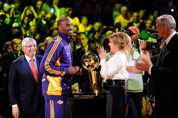 LOS ANGELES, CA - OCTOBER 27:  Kobe Bryant #24 of the Los Angeles Lakers receives his championship ring from Executive Vice President of Business Operations Jeanie Buss before the season opening game against the Los Angeles Clippers at Staples Center on O