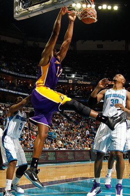 NEW ORLEANS, LA - DECEMBER 29:  Andrew Bynum #17 of the Los Angeles Lakers dunks the ball over Daivd West #30 of the New Orleans Hornets at the New Orleans Arena on December 29, 2010 in New Orleans, Louisiana.   The Lakers defeated the Hornets 103-88.  NO