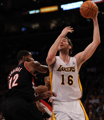 LOS ANGELES, CA - NOVEMBER 07:  Pau Gasol #16 of the Los Angeles Lakers shoots a jump hook over LaMarcus Aldridge #12 of the Portland Trail Blazers at the Staples Center on November 7, 2010 in Los Angeles, California.  NOTE TO USER: User expressly acknowl