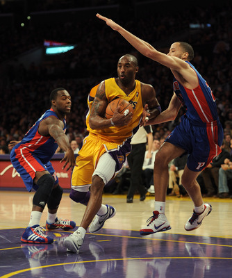 LOS ANGELES, CA - JANUARY 04:  Kobe Bryant #24 of the Los Angeles Lakers steps between Tayshaun Prince #22 and Rodney Stuckey #3 of the Detroit Pistons at the Staples Center on January 4, 2011 in Los Angeles, California. NOTE TO USER: User expressly ackno