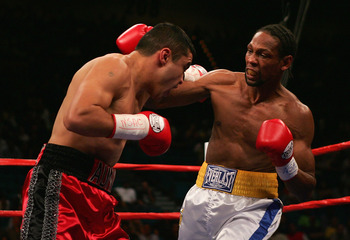 LAS VEGAS - SEPTEMBER 17: Leavander Johnson (R) throws a right against Jesus Chavez during the IBF Lightweight World Title Bout at the MGM Grand Garden Arena on September 17, 2005 in Las Vegas, Nevada. Johnson collapsed in the locker room after the fight