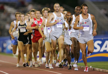 SACRAMENTO, CA - JULY 9:  Bob Kennedy #10 and Ryan Shay #8 of Nike compete in the 10000 Meter Run during the U.S. Olympic Team Track & Field Trials on July 9, 2004 at the Alex G. Spanos Sports Complex in Sacramento, California.  (Photo by Jamie Squire/Get
