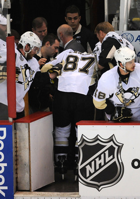 DETROIT - JUNE 12:  Sidney Crosby #87 of the Pittsburgh Penguins is helped off the ice after getting injured against the Detroit Red Wings during Game Seven of the 2009 NHL Stanley Cup Finals at Joe Louis Arena on June 12, 2009 in Detroit, Michigan.  (Pho