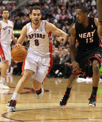 TORONTO, CANADA - FEBRUARY 16:  Jose Calderon #8 of the Toronto Raptors tries to drive around Mario Chalmers #15 of the Miami Heat in a game on February 16, 2011 at the Air Canada Centre in Toronto, Canada. The Heat defeated the Raptors 103-95. (Photo by