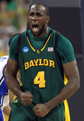 HOUSTON - MARCH 28:  Forward Quincy Acy #4 of the Baylor Bears reacts after making a slam dunk against the Duke Blue Devils during the south regional final of the 2010 NCAA men's basketball tournament at Reliant Stadium on March 28, 2010 in Houston, Texas