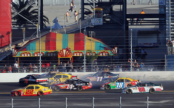 DAYTONA BEACH, FL - FEBRUARY 20:  Regan Smith, driver of the #78 Furniture Row Racing Chevrolet, spins out in front of competitors causing a crash on the backstretch on the 196th lap during the NASCAR Sprint Cup Series Daytona 500 at Daytona International