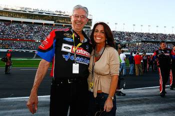 DAYTONA BEACH, FL - FEBRUARY 20:  NASCAR legend Leonard Wood celebrates Lori Banks with after Trevor Bayne, driver of the #21 Motorcraft/Quick Lane Ford, won the NASCAR Sprint Cup Series Daytona 500 at Daytona International Speedway on February 20, 2011 i