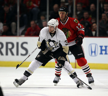 CHICAGO, IL - FEBRUARY 20: Alex Goligoski #3 of the Pittsburgh Penguins looks to pass in front of Ryan Johnson #17 of the Chicago Blackhawks at the United Center on February 20, 2011 in Chicago, Illinois. (Photo by Jonathan Daniel/Getty Images)