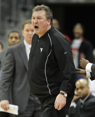 LOUISVILLE, KY - JANUARY 26:  Bob Huggins the Head Coach of the West Virginia Mountaineers screams at a game offical after earning a techical foul during the Big East Conference game against the Louisville Cardinals at the KFC Yum! Center on January 26, 2