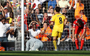 LIVERPOOL, ENGLAND - AUGUST 15:  Pepe Reina of Liverpool scores an own goal during the Barclays Premier League match between Liverpool and Arsenal at Anfield on August 15, 2010 in Liverpool, England.  (Photo by Clive Brunskill/Getty Images)