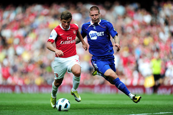 LONDON, ENGLAND - SEPTEMBER 11:  Andrei Arshavin of Arsenal is tackled by Gretar Steinsson of Bolton during the Barclays Premier League match between Arsenal and Bolton Wanderers at The Emirates Stadium on September 11, 2010 in London, England.  (Photo by