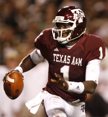 COLLEGE STATION, TX - NOVEMBER 26: Quarterback Jerrod Johnson #1 of the Texas A&M Aggies looks to throw the ball downfield to an open receiver against the Texas Longhorns in the second half at Kyle Field on November 26, 2009 in College Station, Texas. The