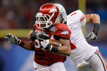 NEW ORLEANS, LA - JANUARY 04:  Joe Adams #3 of the Arkansas Razorbacks runs after a catch against Devon Torrence #1 of the Ohio State Buckeyes in the second half during the Allstate Sugar Bowl at the Louisiana Superdome on January 4, 2011 in New Orleans,