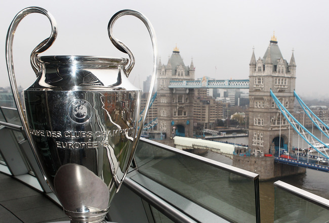 LONDON, ENGLAND - FEBRUARY 17:  The Trophy is pictured in front of Tower Bridge during the UEFA Champions League Final 2011 Ticket Launch at City Hall on February 17, 2011 in London, England.  (Photo by Dean Mouhtaropoulos/Getty Images)