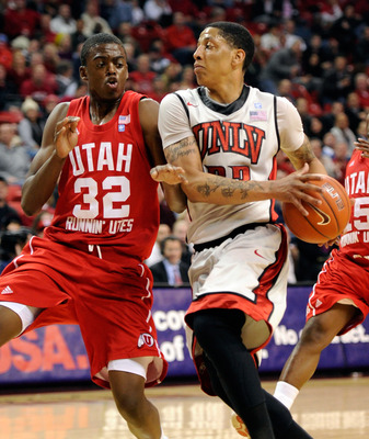 LAS VEGAS, NV - FEBRUARY 02:  Tre'Von Willis #33 of the UNLV Rebels drives against Shawn Glover #32 of the Utah Utes during their game at the Thomas & Mack Center February 2, 2011 in Las Vegas, Nevada. UNLV won 67-54.  (Photo by Ethan Miller/Getty Images)