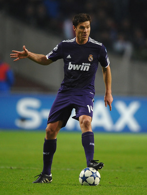 AMSTERDAM, NETHERLANDS - NOVEMBER 23:  Xabi Alonso of Real Madrid in action during the UEFA Champions League Group G match between AFC Ajax and Real Madrid at the Ajax Arena on November 23, 2010 in Amsterdam, Netherlands.  (Photo by Laurence Griffiths/Get