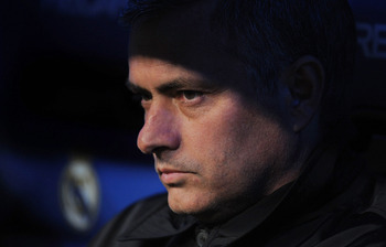 MADRID, SPAIN - FEBRUARY 19:  Head coach Jose Mourinho of Real Madrid looks out from the subs bench before the start of the La Liga match between Real Madrid and Levante at Estadio Santiago Bernabeu on February 19, 2011 in Madrid, Spain.  (Photo by Denis