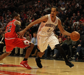CHICAGO, IL - FEBRUARY 15: Shaun Livingston #2 of the Charlotte Bobcats moves around C.J. Watson #32 of the Chicago Bulls at the United Center on February 15, 2011 in Chicago, Illinois. The Bulls defeated the Bobcats 106-94. NOTE TO USER: User expressly a