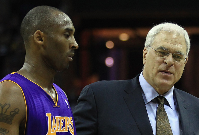 CHARLOTTE, NC - FEBRUARY 14:  Head coach Phil Jackson talks to Kobe Bryant #24 of the Los Angeles Lakers during their game against the Charlotte Bobcats at Time Warner Cable Arena on February 14, 2011 in Charlotte, North Carolina. NOTE TO USER: User expre
