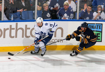 BUFFALO, NY - FEBRUARY 16: Joffrey Lupul #19  of the Toronto Maple Leafs controls the puck ahead of Andrej Sekera #44 of the Buffalo Sabres  at HSBC Arena on February 16, 2011 in Buffalo, New York.  (Photo by Rick Stewart/Getty Images)