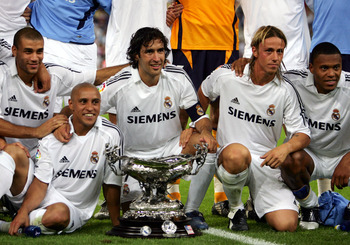 MADRID, SPAIN - AUGUST 23:  (2ndL-R) Real Madrid's Roberto Carlos, Raul Gonzalez, Jose Maria Gutierrez Hernandez and Julio Baptista pose with the Santiago Bernabeu trophy after beating a U.S. Major League Soccer all-star selection 5-0 at the Bernabeu on A