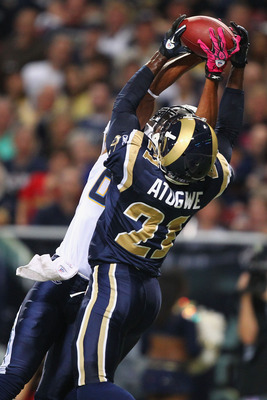 ST. LOUIS - OCTOBER 17: Oshiomogho Atogwe #21 of the St. Louis Rams intercepts a pass against the San Diego Chargers at the Edward Jones Dome on October 17, 2010 in St. Louis, Missouri.  The Rams beat the Chargers 20-17.  (Photo by Dilip Vishwanat/Getty I