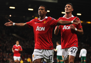 MANCHESTER, ENGLAND - OCTOBER 20:  Luis Nani of Manchester United celebrates with Federico Macheda (R) as he scores their first goal during the UEFA Champions League Group C match between Manchester United and Bursaspor Kulubu at Old Trafford on October 2