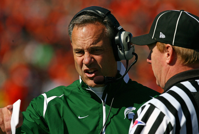 CHAMPAIGN, IL - OCTOBER 10: Head coach Mark Dantonio of the Michigan State Spartans argues with a referee during a game against the Illinois Fighting Illini on October 10, 2009 at Memorial Stadium at the University of Illinois in Champaign, Illinois. Mich