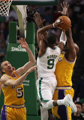 BOSTON, MA - FEBRUARY 10:  Steve Blake #5 and Lamar Odom #7 of the Los Angeles Lakers try to block Rajon Rondo #9 of the Boston Celtics on February 10, 2011 at the TD Garden in Boston, Massachusetts.  The Lakers defeated the Celtics 92-86. NOTE TO USER: U