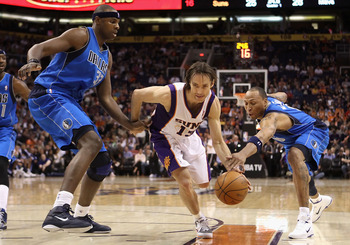 PHOENIX, AZ - FEBRUARY 17:  Steve Nash #13 of the Phoenix Suns drives the ball between Brendan Haywood #33 and Shawn Marion #0 of the Dallas Mavericks during the NBA game at US Airways Center on February 17, 2011 in Phoenix, Arizona.  NOTE TO USER: User e