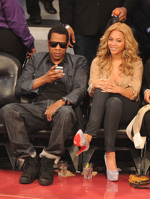LOS ANGELES, CA - FEBRUARY 20:  Jay-Z (L) and singer Beyonce Knowles during the 2011 NBA All-Star game at Staples Center on February 20, 2011 in Los Angeles, California. NOTE TO USER: User expressly acknowledges and agrees that, by downloading and or usin