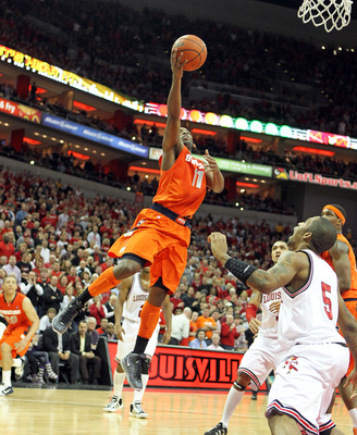 LOUISVILLE, KY - FEBRUARY 12:  Scoop Jardine #11 of the Syracuse Orange shoots the ball during the Big East Conference game against the Louisville Cardinals at the KFC Yum! Center on February 12, 2011 in Louisville, Kentucky.  Louisville won 73-69.  (Phot