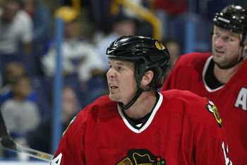 ST. LOUIS - OCTOBER 4:  Right wing Theo Fleury #14 of the Chicago Blackhawks looks on against the St. Louis Blues during the NHL preseason game on October 4, 2002 at the Savvis Center in St. Louis, Missouri.  The St. Louis Blues beat the Chicago Blackhawk
