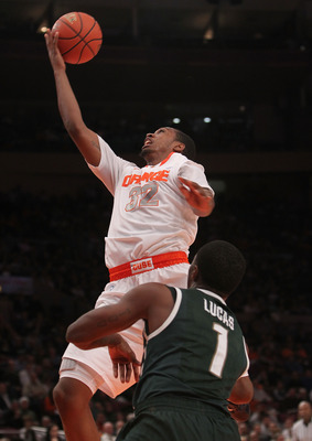 NEW YORK, NY - DECEMBER 07: Kris Joseph #32 of Syracuse Orange lays the ball up against the Michigan State Spartans during their game at the Jimmy V Classic at Madison Square Garden on December 7, 2010 in New York City.  (Photo by Nick Laham/Getty Images)