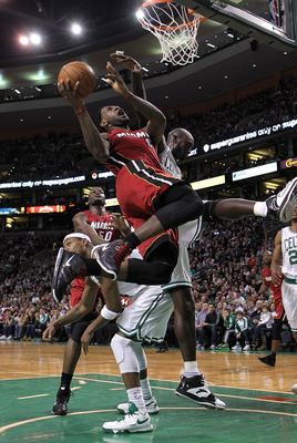 BOSTON - FEBRUARY 13:  LeBron James #6 of the Miami Heat drives  against Kevin Garnett #5 of the Boston Celtics at TD Garden on February 13, 2011 in Boston, Massachusetts. NOTE TO USER: User expressly acknowledges and agrees that, by downloading and/or us