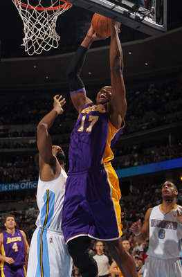DENVER, CO - JANUARY 21:  Andrew Bynum #17 of the Los Angeles Lakers takes a shot against Nene #31 of the Denver Nuggets at the Pepsi Center on January 21, 2011 in Denver, Colorado. NOTE TO USER: User expressly acknowledges and agrees that, by downloading