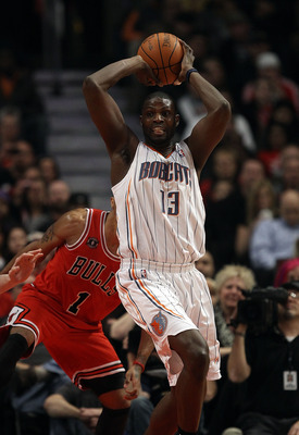 CHICAGO, IL - FEBRUARY 15: Nazr Mohammed #13 of the Charlotte Bobcats controls a rebound in front of Derrick Rose #1 of the Chicago Bulls at the United Center on February 15, 2011 in Chicago, Illinois. The Bulls defeated the Bobcats 106-94. NOTE TO USER: