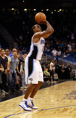 ORLANDO, FL - OCTOBER 10:  Chris Duhon #25 of the Orlando Magic attempts a shot during the game against the New Orleans Hornets at Amway Arena on October 10, 2010 in Orlando, Florida. NOTE TO USER: User expressly acknowledges and agrees that, by downloadi