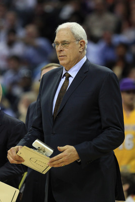 CHARLOTTE, NC - FEBRUARY 14:  Head coach Phil Jackson of the Los Angeles Lakers against the Charlotte Bobcats during their game at Time Warner Cable Arena on February 14, 2011 in Charlotte, North Carolina. NOTE TO USER: User expressly acknowledges and agr