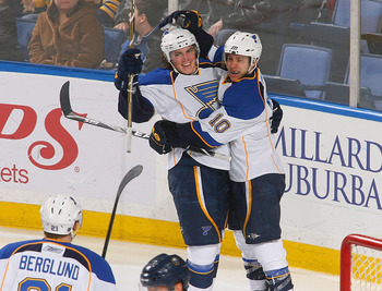 BUFFALO, NY - FEBRUARY 18: TJ Oshie #74 and Andy McDonald #10 of the St. Louis Blues celebrate Oshie's goal in the second period against the Buffalo Sabres at HSBC Arena on February 18, 2011 in Buffalo, New York.  (Photo by Rick Stewart/Getty Images)