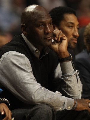 CHICAGO, IL - FEBRUARY 15: Former players Michael Jordan and Scottie Pippen of the Chicago Bulls watch a game between the Bulls and the Charlotte Bobcats at the United Center on February 15, 2011 in Chicago, Illinois. The Bulls defeated the Bobcats 106-94