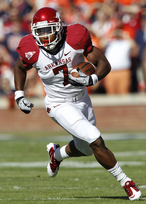 AUBURN, AL - OCTOBER 16:  Running back Knile Davis #7 of the Arkansas Razorbacks runs with the ball during the game against the Auburn Tigers at Jordan-Hare Stadium on October 16, 2010 in Auburn, Alabama.  The Tigers beat the Razorbacks 65-43.  (Photo by