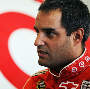 DAYTONA BEACH, FL - FEBRUARY 19:  Juan Pablo Montoya, driver of the #42 Target Chevrolet, stands in the garage during practice for the NASCAR Sprint Cup Series Daytona 500 at Daytona International Speedway on February 19, 2011 in Daytona Beach, Florida.