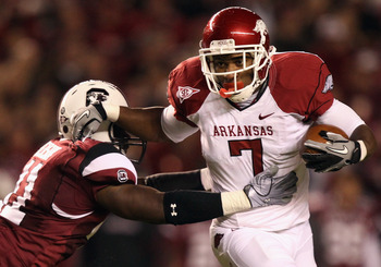 COLUMBIA, SC - NOVEMBER 06:  Knile Davis #7 of the Arkansas Razorbacks pushes away from Josh Dickerson #41 of the South Carolina Gamecocks during their game at Williams-Brice Stadium on November 6, 2010 in Columbia, South Carolina.  (Photo by Streeter Lec
