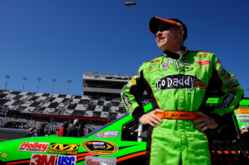 DAYTONA BEACH, FL - FEBRUARY 13:  Mark Martin, driver of the #5 GoDaddy.com Chevrolet, stands on the grid during qualifying for the NASCAR Sprint Cup Series Daytona 500 at Daytona International Speedway on February 13, 2011 in Daytona Beach, Florida.  (Ph