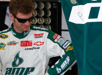 DAYTONA BEACH, FL - FEBRUARY 19:  Dale Earnhardt Jr., driver of the #88 National Guard/AMP Energy Chevrolet, looks on in the garage area during practice for the NASCAR Sprint Cup Series Daytona 500 at Daytona International Speedway on February 19, 2011 in